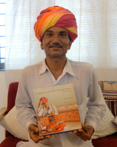 Dx Kojaram Holding the book